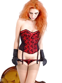 Cute Redhead Chiara wearing tight leather gloves and silky..