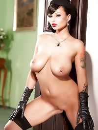 Busty Dominno drops her corset