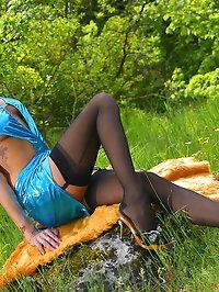 Leggy beauty in black stockings outdoor