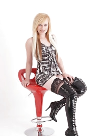 Filthy blonde tart with long hair and longer leather boots