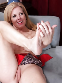 Horny blonde housewife strips and licks her gorgeous..