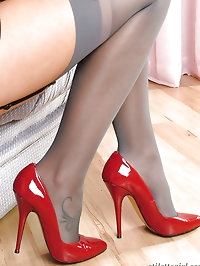 Red hair with matching red high heels on this little stunner