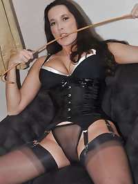 Nylon Mistress Jane showing off with her cane