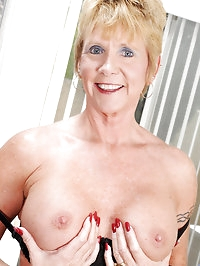 Sexy blonde mature granny fingers her pierced pussy while..