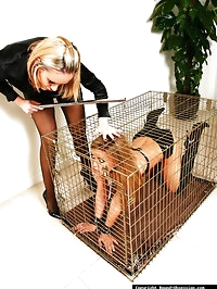 This sexy Milf taunts this gorgeous blonde in her cage..