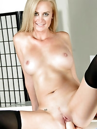 Blonde cougar Camryn Cross flaunts her big tits and..