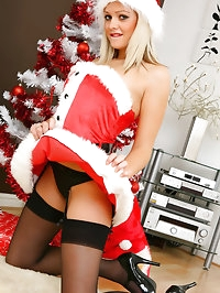 Beautiful blonde Melissa gives you a christmas treat as..