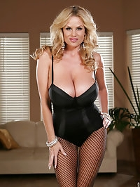 Kelly in black lingerie tears open her fishnets and rubs..