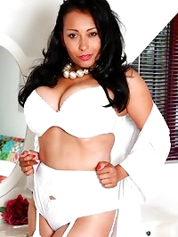 Danica ready for bed in white lingerie, stockings and..