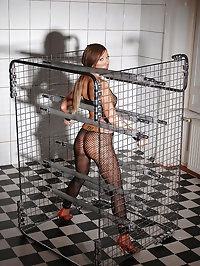 Natalia Forrest gets bound in cage