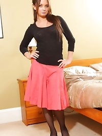 Annabella in a tight black top and cute red summer skirt.