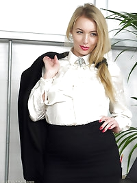 Blonde secretary in seamed stockings shows her secrets in..